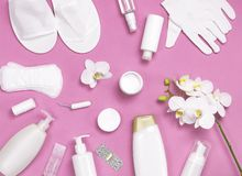 Spa concept cosmetology medicine plastic surgery branding mock-up. White cosmetic bottle gloves slippers hygiene items gasket. Tampon cotton pads injections royalty free stock images