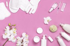 Spa concept cosmetology medicine plastic surgery branding mock-up. White cosmetic bottle gloves slippers hygiene items gasket. Tampon cotton pads injections stock photo