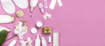 Spa concept cosmetology medicine plastic surgery branding mock-up. White cosmetic bottle gloves slippers hygiene items gasket. Tampon cotton pads injections stock images