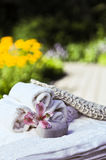 Spa concept with flower, stone and washcloth Stock Photo