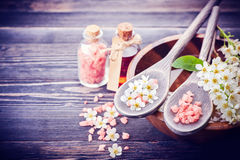 Spa concept. Flowers in bowl with water. Sea salt, essential oil massage. Spa and body care. Sea salt, essential oil massage. Flowers in bowl with water stock photography