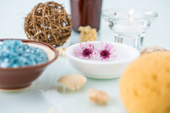 Spa concept with flowers, Candle and Bath Sponge Royalty Free Stock Photo