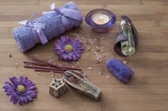 Spa concept. flowers,candles, aromatic salt,soap and  purple tow Stock Photos