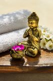 Spa Concept with golden Buddha Royalty Free Stock Photos