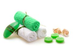 Spa concept of green color. The towel, soap and candles over white background Royalty Free Stock Photo
