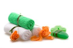 Spa concept of green color. The towel, soap and candles over white background Royalty Free Stock Images