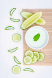 Spa concept, Homemade skin care and body scrub with natural ingr. Edients aloe vera ,lemon and cucumber set up on on wooden background Royalty Free Stock Images