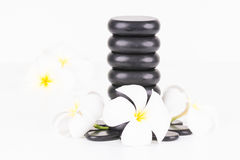 Spa concept with hot stones and Frangipani flowers Stock Photo