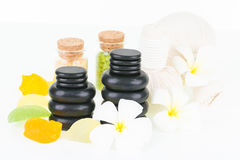 Spa concept with hot stones, herbal compress balls and soaps Royalty Free Stock Photography