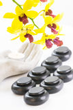 Spa concept with hot stones and tea light Royalty Free Stock Photography