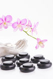 Spa concept with hot stones and tea light Stock Photography
