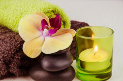 Spa concept with lava stones, orchid and candle Stock Photography