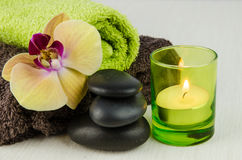 Spa concept with lava stones, orchid and candle Stock Images