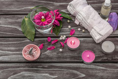 Spa concept. Lavender oil, flowers and bath white towels Stock Image