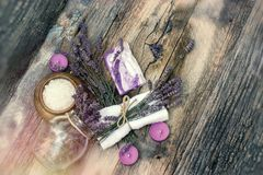Spa concept - lavender soap, scented salt and dry lavender. On rustic wooden table Stock Image