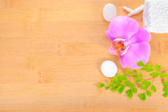 Spa concept, lilac orchid and white towels Royalty Free Stock Photography