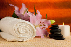 Spa concept of lily flower, towels, sea salt, candle and crystal Royalty Free Stock Image