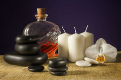 Spa concept - massage stones on purple Stock Image