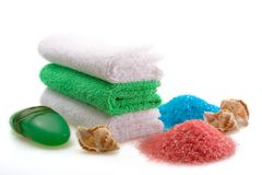 Spa concept of multicolor. Spa concept of green color: the towel, soap and candles over white background Royalty Free Stock Photos