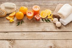 Spa concept with orange fruits on old wooden background Stock Photos