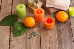 Spa concept with orange fruits on old wooden background Stock Photography