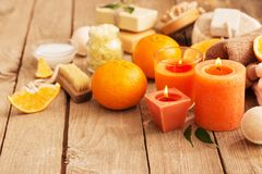 Spa concept with orange fruits on old wooden background Royalty Free Stock Photo