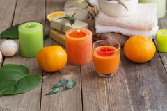 Spa concept with orange fruits on old wooden background Royalty Free Stock Image