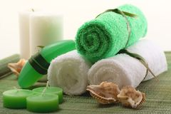 Spa concept over sisal. Spa concept of green color: the towel, soap and candles over sisal background royalty free stock photos