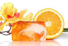Spa concept, peach soap, flower and fresh orange Royalty Free Stock Images