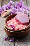 Spa concept with pink salt, soap and flowers Stock Images
