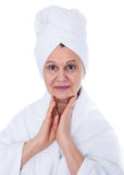 Spa concept portrait. Aged good looking woman with white towel on her headCity background made of many building silhouettes Stock Photo