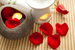 Spa Concept: Rose petals, aroma candles. On bamboo mats stock photography