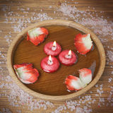 Spa concept with rose petals, salt and burning candles that floa Royalty Free Stock Photography