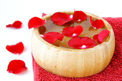 Spa concept with rose petals and  towel Royalty Free Stock Photo