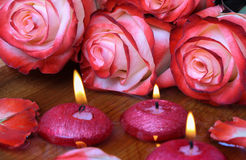 Spa concept with roses and burning candles that float in the wat Royalty Free Stock Image