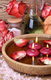 Spa concept with roses, pink salt and candles that float in wate Stock Images