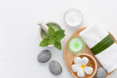 Spa concept with salt, mint, lotion, towel, candle, stone and fl Royalty Free Stock Photography