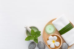 Spa concept with salt, mint, lotion, towel, candle, stone and fl Royalty Free Stock Images