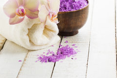 Spa concept. Sea salt with flowers and towel  Stock Photo
