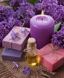 Spa concept. Soap, oil, candle, lilac royalty free stock photo