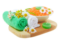 Spa concept: the towel, flowers and candles Royalty Free Stock Image
