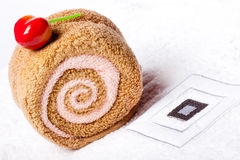 Spa concept, towel roll and sweet cherry berry Royalty Free Stock Image