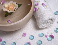 Spa concept with towel and water  Royalty Free Stock Photo