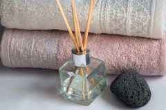 Clean towels, massage stone and fragrance sticks Stock Photos