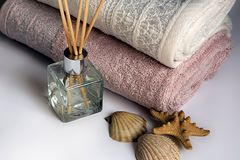Clean towels and fragrance sticks Stock Photography