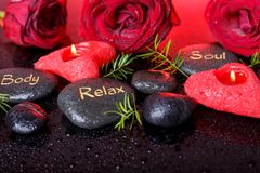 Wellness decoration, Spa concept in Valentine& x27;s Day. Spa concept in Valentine& x27;s Day, red roses, candles in the shape of heart, black therapy stones royalty free stock image