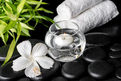 Spa concept of white hibiscus flower, bamboo, round vase and tow Stock Images