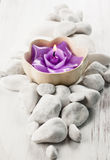 Spa concept. White stones and candle Stock Photography
