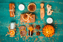 Spa concept on wooden background: Aromatic oils, salt, soap, citrus, cinnamon candles. Stock Photography