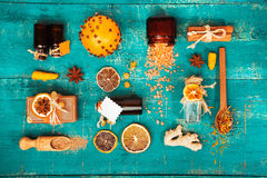 Spa concept on wooden background: Aromatic oils, salt, soap, citrus, cinnamon candles. Stock Image